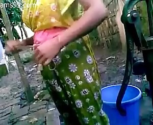 Pretty Youthful Bangladeshi Deshi Lady with Big Hooters Films Herself Bathing Outdoor Butt Naked