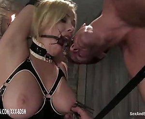 The man predominates on bondage blonde babe in latex
